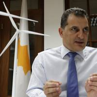 Photo - Energy Minister Yiorgos Lakkotrypis speaks during an interview for the Associated Press at his office in the Cypriot capital Nicosia, Thursday, May 8, 2014. Cyprus' energy minister says a land-based facility to process new offshore gas finds remains a top priority, but the search for additional sources of the fuel must move quickly to keep up with a rapidly shifting market. (AP Photo/Petros Karadjias)