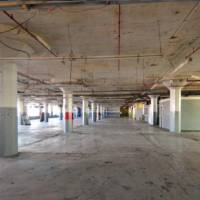 Photo -  The interior floors of the former Fred Jones Manufacturing Co. plant at 900 W Main appear much as they did when the building was first built as a Ford Motor Co. assembly plant in 1916. PHOTO PROVIDED    Provided