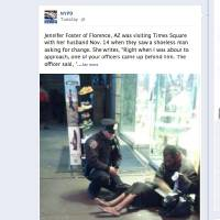 Photo - This screen shot taken from the NYPD Facebook page Thursday Nov. 29, 2012 shows a photo taken by Arizona tourist Jennifer Foster of New York City Police Officer Larry DePrimo presenting a barefoot homeless man in New York's Time Square with boots on Nov. 14, 2012. Foster was visiting New York with her husband on Nov. 14, when she came across the shoeless man asking for change in Times Square. As she was about to approach him, she said the officer  came up to the man with a pair of all-weather boots and thermal socks on the frigid night. She took the picture on her cellphone. It was posted Tuesday night to the NYPD's official Facebook page and became an instant hit. More than 350,000 users