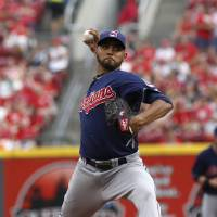 Photo - Cleveland Indians starting pitcher Danny Salazar throws against the Cincinnati Reds during the first inning of a baseball game, Wednesday, Aug. 6, 2014, in Cincinnati. (AP Photo/David Kohl)