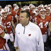 Photo - FILE - In this Dec. 1, 2012, file photo, Wisconsin coach Bret Bielema waits to take the field with his team before the Big Ten championship NCAA college football game against Nebraska in Indianapolis. A person familiar with the situation tells The Associated Press on Tuesday, Dec. 4, 2012, that Bielema has agreed to become the new coach at Arkansas. (AP Photo/Darron Cummings, File)