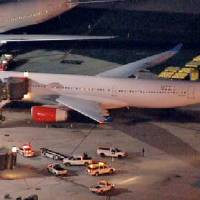 Photo - In this image taken from video and provided by television station WNBC-TV, a damaged SAS Airbus A330 sits on the tarmac at New Liberty International Airport after clipping the wing of another aircraft on takeoff, Wednesday, May 1, 2013 in Newark, N.J. Federal Aviation Administration officials say no one was injured in the incident at about 7:30 p.m. (AP Photo/WNBC-TV) MANDATORY CREDIT
