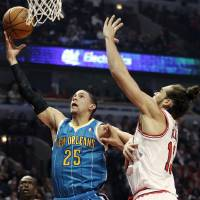 Photo -   New Orleans Hornets guard Austin Rivers (25) drives to the basket against Chicago Bulls center Joakim Noah (13) during the first half of an NBA basketball game in Chicago, Saturday, Nov. 3, 2012. (AP Photo/Nam Y. Huh)