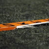 Photo -  A broken OSU fan's paddle fell to the sideline during the Bedlam college football game between the University of Oklahoma Sooners (OU) and the Oklahoma State University Cowboys (OSU) at Boone Pickens Stadium in Stillwater, Okla., Saturday, Nov. 27, 2010. OU won, 47-41. Photo by Nate Billings, The Oklahoman ORG XMIT: KOD