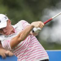 Photo - Stacy Lewis hits from the 10th tee box during the second round of the NW Arkansas Championship golf tournament on Sunday, June 29, 2014, in Rogers, Ark. (AP Photo/Beth Hall)