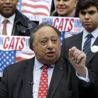 Photo - Surrounded by supporters, John Catsimatidis talks to the media during a news conference on the steps of City Hall in New York, Tuesday, Jan. 29, 2013. Catsimatidis announced his intention to run for New York City mayor. (AP Photo/Seth Wenig)