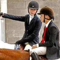 Photo -  Sage Rasmussen talks with fellow Working Hunter Class rider Colby Dirck during the Cleveland County Free Fair Horse Show at the fairgrounds. PHOTO BY STEVE SISNEY, THE OKLAHOMAN   STEVE SISNEY -