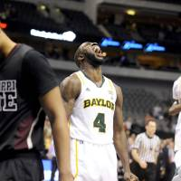 Photo - Baylor forward Quincy Acy (4) celebrates the Bears 54-52 win of after  NCAA college basketball game against Mississippi State, in Dallas, Wednesday, Dec. 28, 2011. (AP Photo/Matt Strasen) ORG XMIT: TXMS115