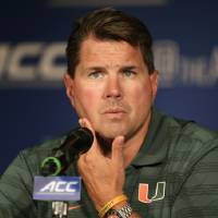 Photo - Miami head coach Al Golden answers a question during a news conference at the Atlantic Coast Conference Football kickoff in Greensboro, N.C., Monday, July 21, 2014. (AP Photo/Chuck Burton)
