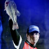 Photo - Angler Cliff Pace from Mississippi holds up the fish he caught during Saturday's weigh-in for the Bassmaster Classic at the BOK Center in Tulsa. PHOTO BY JAMES GIBBARD, TULSA WORLD