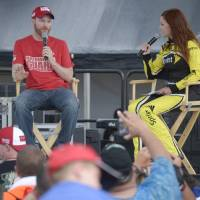 Photo - Dale Earnhardt Jr., left, talks with Miss Sprint Cup, Madision Martin, during an interview after he was named NASCAR's most popular driver prior to the Sprint cup Series auto race at Daytona International Speedway in Daytona Beach, Fla., Saturday, July 5, 2014. (AP Photo/Phelan M. Ebenhack)