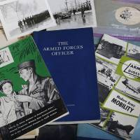 Photo - Rick Cacini donated items from his late father's collection of World War II and Korea items to the 45th Infantry Museum and the Fort Reno Museum.