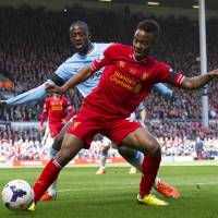Photo - Liverpool's Raheem Sterling, right, keeps the ball from Manchester City's Yaya Toure during their English Premier League soccer match at Anfield Stadium, Liverpool, England, Sunday April 13, 2014. (AP Photo/Jon Super)