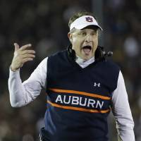 Photo - FILE - In this Jan. 6, 2014, file photo, Auburn head coach Gus Malzahn yells during the first half of the NCAA BCS National Championship college football game against Florida State in Pasadena, Calif. Malzahn has a long way to go to challenge Alabama coach Nick Saban's résumé that includes three national titles at Alabama and one at LSU. His Tigers open against his home state team, Arkansas, on Saturday Aug. 30, 2014.(AP Photo/David J. Phillip, File)