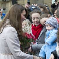 Photo - FILE - In this Wednesday Nov. 28, 2012 file photo Britain's Kate Duchess of Cambridge. left. meets with a young member of the public as she arrives at the Guildhall during a visit to Cambridge England. Prince William's wife Kate has been admitted to the hospital in early stages of labor it was announced on Monday July 22, 2013.  (AP Photo/Arthur Edwards, File)