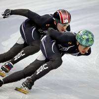 Photo - United States short track speed skating teammates J.r. Celski, right, and Christopher Creveling run through a training session at the Iceberg Skating Palace at the 2014 Winter Olympics, Sunday, Feb. 2, 2014, in Sochi, Russia. (AP Photo/David Goldman)