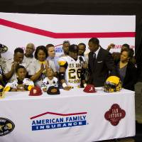 Photo - Heritage Hall standout Barry J. Sanders announces his commitment to Stanford at the U.S. Army All-America Bowl in San Antonio on Saturday. PHOTO COURTESY U.S. ARMY  Aurora Imaging Company