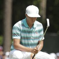 Photo - Rickie Fowler lines up his putt on the sixth hole during the third round of the U.S. Open golf tournament in Pinehurst, N.C., Saturday, June 14, 2014. (AP Photo/Charlie Riedel)
