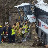 Photo - Emergency and rescue crews respond to the scene of a tour bus crash on the Pennsylvania Turnpike on Saturday, March 16, 2013 near Carlisle, Pa.  Authorities say the tour bus crashed on the freeway at mile marker 227 in central Pennsylvania, and serious injuries have been reported.  Megan Silverstram of the Cumberland County public safety department says the crash in the eastbound lanes of the Pennsylvania Turnpike was reported just before 9 a.m. Saturday. She says there are reports of multiple injuries, including that some are serious. (AP Photo/The Sentinel, Jason Malmont ) MANDATORY CREDIT