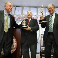 Photo - Journalism professor and reporter Mike Boettcher, left, donates his two Emmy Awards to the Gaylord College of Journalism and Mass Communication at OU on Tuesday. Accepting are OU President David Boren, center, and Joe Foote, college dean.  Photo by Steve Sisney, The Oklahoman