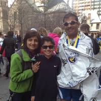 Photo - Raj Patel, right, his son Syon, center, and his wife after the Boston Marathon. Photo provided