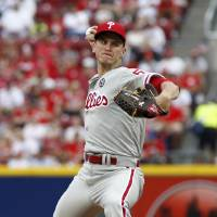 Photo - Philadelphia Phillies starting pitcher David Buchanan throws against the Cincinnati Reds during the first inning of a baseball game, Sunday, June 8, 2014, in Cincinnati. (AP Photo/David Kohl)