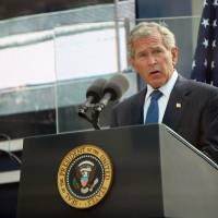 Photo -   FILE - In this Sept. 11, 2011 file photo, former U.S. President George W. Bush addresses those attending the 10th anniversary commemoration of the terrorist attacks on the World Trade Center in New York. For the first time, elected officials won't be allowed to speak Tuesday, Sept. 11, 2012, at an occasion that has allowed them a solemn turn in the spotlight, a change made in the name of avoiding politics, but rapped by some as a political move in itself. (AP Photo/Allan Tannenbaum, Pool, File)