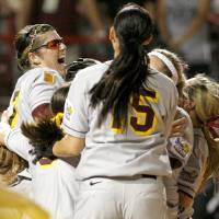 Photo - COLLEGE SOFTBALL, CELEBRATE, CELEBRATION: Arizona State's Katie Burkhart celebrates after winning the championship game of the Women's College World Series between Texas A&M University and Arizona State University at ASA Hall of Fame Stadium in Oklahoma City, Tuesday, June 3, 2008. BY BRYAN TERRY, THE OKLAHOMAN ORG XMIT: KOD ORG XMIT: OKC0806032210389990 ORG XMIT: 0806032345180145