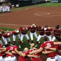 Photo - Oklahoma cheers before the Norman Regional of the 2013 NCAA Division I Softball Women's College World Series as the University of Oklahoma (OU) Sooners play the Arkansas Razorbacks at Marita Hines Field, Sunday, May 19, 2013. Photo by Sarah Phipps, The Oklahoman