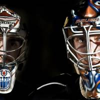 Photo - HOCKEY HELMETS: Barons' David LeNeveu  and Olivier Roy, from left, wear their goalie mask at the Cox Convention Center on Feb. 21, 2012 in Oklahoma City, Oklahoma. Photo by Chris Landsberger