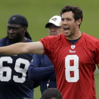 Photo - St. Louis Rams quarterback Sam Bradford calls out at the line of scrimmage during an organized team activity at the NFL football team's practice facility Thursday, June 5, 2014, in St. Louis. (AP Photo/Jeff Roberson)