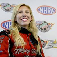 Photo - Funny Car driver Courtney Force cracks a smile while talking about her qualifying run for the NHRA Kansas Nationals on Saturday May 24, 2014, that broke a track record at Heartland Park in Topeka, Kan., with a time of 4.009 seconds at 322.96 mph. (AP Photo/Topeka Capital-Journal, Chris Neal)