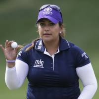 Photo - Lizette Salas tips her ball to the crowd on the ninth hole during the final round of the Kingsmill Championship golf tournament at the Kingsmill resort  in Williamsburg, Va., Sunday, May 18, 2014.  Salas birdied the par-3 hole.  (AP Photo/Steve Helber)