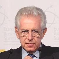 Photo -   FILE This Thursday, April 26, 2012 file photo shows Italy's Prime Minister Mario Monti addressing the start of the 10th European Business summit in Brussels. Mario Monti, hailed as a savior in November when he was named premier to tackle Italy's financial crisis, is feeling the sting as he comes under attack from all sides _ variously described as a cold-hearted economist, a slave to the banks or a softie lacking the courage to push harder with reforms. The resounding anti-austerity votes in elections in France, Greece and Germany's most populous state have piled pressure on Monti, who needs to placate an increasingly restive population while persuading markets that it's safe to lend to a nation whose public debt stands at a staggering 120 percent of GDP. Adding to the urgency, Italy announced this week that it fell deeper into recession with its economy shrinking for the third straight quarter in its biggest contraction since 2009.(AP Photo/Yves Logghe)