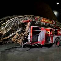 Photo - In this May 5, 2014 photo released by the National September 11 Memorial Museum, a firetruck, damaged in the attacks of September 11, 2001, is on display at the New York museum. The long-delayed museum will be dedicated during a ceremony Thursday, May 15, 2014. (AP Photo/ National September 11 Memorial Museum, Jin Lee)