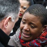 Photo - Cleopatra Pendelton cries as she talks with Chicago Police Superintendent Garry McCarthy before a news conference seeking help from the public in solving the murder of Pendelton's daughter Hadiya Wednesday, Jan. 30, 2013, in Chicago. Hadiya, 15, who had performed in President Barack Obama's inauguration festivities, was killed in a Chicago park as she talked with friends by a gunman who apparently was not even aiming at her. The city's 42nd slaying is part of Chicago's bloodiest January in more than a decade, following on the heels of 2012, which ended with more than 500 homicides for the first time since 2008. It also comes at a time when Obama, spurred by the Connecticut elementary school massacre in December, is actively pushing for tougher gun laws. (AP Photo/Charles Rex Arbogast)