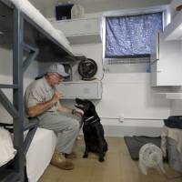 Photo -  Inmate Steve Griffith sits in his prison cell with Dillard at the Lexington Assessment and Reception Center, Friday, July 11,  2013, in Lexington, Okla. Dillard was rescued after the May tornado.Photo by Sarah Phipps, The Oklahoman