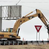Photo - Crews contracted by the state Transportation Department have started work on the Main Street interchange at Interstate 35 in Norman. PHOTOS BY STEVE SISNEY, THE OKLAHOMAN