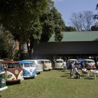 Photo - In this Aug. 25, 2013 photo, members of the Sampa Kombi club, a group ofVolkswagen van owners, gather for their monthly meeting, in Sao Paulo, Brazil. In Brazil the VW van is known as the