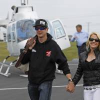 Photo - Kurt Busch walk with his girlfriend, Patricia Driscoll, after arriving for the NASCAR Sprint All-Star auto race at Charlotte Motor Speedway in Concord, N.C., Saturday, May 17, 2014. Busch qualified earlier Saturday for the Indianapolis 500. (AP Photo/Terry Renna)