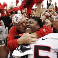 Photo - ** FILE **In this Nov. 11, 2006 file photo, Georgia fan Mike Woods of Colbert, Ga., kisses Georgia player Jeff Owens after the Bulldogs defeated No. 5 Auburn 37-15 in a college football game in Auburn, Ala. Owens is considered a possible first-round pick in the 2009 NFL draft. That doesn't make the Georgia senior defensive tackle feel comfortable about his starting job. Owens says the depth on No. 1 Georgia's line means he could be a backup any week. (AP Photo/Rob Carr, File) ORG XMIT: AX103