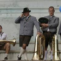 Photo -   Musicians of the Oktoberfest orchestra await the start of the famous Oktoberfest beer festival concert in Munich, southern Germany, Sunday, Sept. 30, 2012. The world's largest beer festival, to be held from Sept. 22 to Oct. 7, 2012 will see some million visitors. (AP Photo/Matthias Schrader)