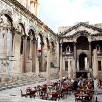 Photo - Diocletian's former entry hall is now Split's main square, the Peristyle. Here Roman ruins and the cathedral coexist with shops, coffee-sipping Croatians, and bars blasting live music at night, when the smooth marble tiles turn into a dance floor. Photo by Cameron Hewitt