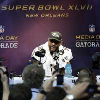 Photo - Baltimore Ravens linebacker Ray Lewis speaks during media day for the NFL Super Bowl XLVII football game Tuesday, Jan. 29, 2013, in New Orleans. (AP Photo/Mark Humphrey)