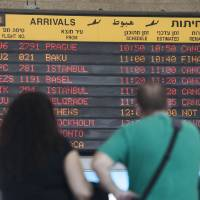 Photo - A arrivals flight board displays various canceled and delayed flights in Ben Gurion International airport a day after the U.S. Federal Aviation Administration imposed a 24-hour restriction on flights after a Hamas rocket landed Tuesday within a mile of the airport, in Tel Aviv, Israel, Wednesday, July 23, 2014. U.S. Secretary of State John Kerry flew into Israel's main airport Wednesday despite a Federal Aviation Administration ban in an apparent sign of his determination to achieve a cease-fire agreement in the warring Gaza Strip despite little evidence of progress in ongoing negotiations. (AP Photo/Dan Balilty)