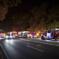 Photo - Emergency response vehicles wait outside the apartment complex where Miriam Carey is believed to have lived in Stamford, Conn. Thursday, Oct. 3, 2013.  Law-enforcement authorities have identified Carey, 34, as the woman who, with a 1-year-old child in her car, led Secret Service and police on a harrowing chase in Washington from the White House past the Capitol Thursday, attempting to penetrate the security barriers at both national landmarks before she was shot to death, police said. The child survived.  (AP Photo/John Minchillo)