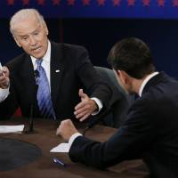 Photo - FILE - This Oct. 11, 2012 file photo shows Vice President Joe Biden, left, and Republican vice presidential nominee Rep. Paul Ryan of Wisconsin participating in the vice presidential debate at Centre College in Danville, Ky. Biden tangled with Ryan in a televised debate and responded to Ryan's comments about foreign policy,