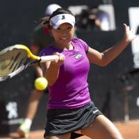 Photo - Kurumi Nara of Japan, returns to Klara Zakopalova of the Czech Republic   during the finals  at the Rio Open tennis tournament in Rio de Janeiro, Brazil, Sunday, Feb.23, 2014. (AP Photo/Silvia Izquierdo)