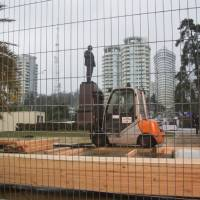 """Photo - In this photo taken on Thursday, Jan.  23, 2014 a statue of Lenin stands in a central park in Sochi, Russia, surrounded by temporary fencing where workers are putting up one of the Olympic """"live sites"""".   The Russian Black Sea resort of Sochi is hosting the Winter Games on Feb. 7-23.  (AP Photo/Nataliya Vasilyeva)"""