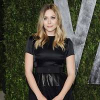 "Photo - FILE - This Feb. 26, 2012 file photo shows actress Elizabeth Olsen arrives at the Vanity Fair Oscar party in West Hollywood, Calif. Olsen will soon be a star-crossed lover _ she'll star in an off-Broadway version of Shakespeare's ""Romeo & Juliet."" Classic Stage Company said Thursday that the younger sister of Mary-Kate and Ashley Olsen will help will kick off their 2013/2014 season. (AP Photo/Evan Agostini, file)"